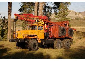 Лесовозный автопоезд с манипулятором Урал (9047L)